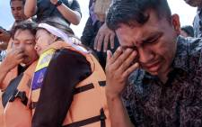 Family members of missing victims of a capsized ferry mourn during a mass memorial service at Lake Toba in North Sumatra on 3 July 2018. Picture: AFP.