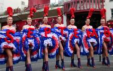 Dancers from the Moulin Rouge cabaret, wearing French cancan outfits, pose for photographers, on 17 May 2021 in Paris, to announce the cabaret's reopening next September 10. Picture: AFP