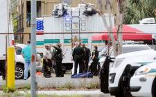 Investigators work the scene of a multiple shooting at an area business in an industrial area on 5 June 2017 northeast of downtown Orlando, Florida. Picture: Getty Images/AFP