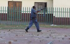 Residents of Bekkersdal on Gauteng's West Rand clash with police during a service dilevery protest on 23 October. Picture: Sebabatso Mosamo/EWN