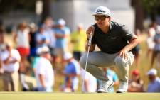 Garrick Higgo of South Africa lines up a putt on the 18th green during the final round of the Palmetto Championship at Congaree on 13 June 2021 in Ridgeland, South Carolina. Picture: Mike Ehrmann/AFP