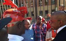 The EFF's Dali Mpofu addresses supporters outside the North Gauteng High Court in Pretoria on 26 May, 2014. Picture: Masego Rahlaga/EWN.