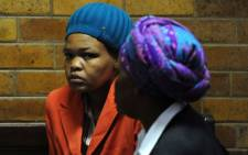 Venolia Siwa at the Vryburg Circuit Court on Tuesday, 4 September 2012 where she was found guilty of killing her five children. Picture: Sapa.