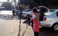 Journalists camped outside a Pretoria hospital waiting for news about Former President Nelson Mandela's health. Picture: Shain Germaner/EWN.