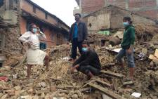 Gift of the Givers walk through an area hit by the quake. Scores of collapsed buildings. Picture: Mia Lindeque/EWN