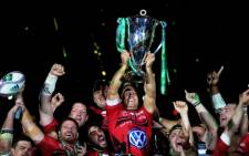 Toulon's English fly-half Jonny Wilkinson (C) raises the European Cup after winning the final rugby union match between RC Toulon and Saracens at The Millennium Stadium in Cardiff, South Wales on 24 May,2014. Picture: AFP.