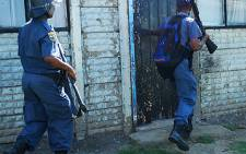 Sakhile police raid several houses in the township searching for the people they believe are responsible for inciting violence. Picture: Taurai Maduna.