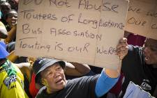 Long distance bus drivers gather outside the Cape Town Civic Buildings protesting against having to purchase new permits for their buses. Picture: Thomas Holder/EWN