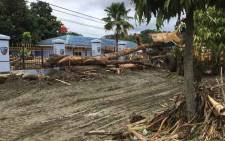 Debris and uprooted trees away by flash floods are seen in Sentani near the provincial capital of Jayapura, Indonesia's eastern Papua province, on 17 March 2019. Flash floods in Indonesia's eastern Papua province have killed at least 50 people, an official said on 17 March, as rescuers battled mud, rocks and fallen trees in the hunt for survivors. Picture: AFP