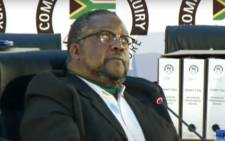 A screengrab of former Police Minister Nathi Nhleko giving evidence at the state capture inquiry on 29 July 2020.
