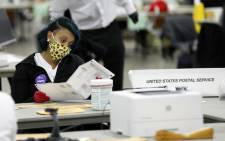 Detroit election workers work on counting absentee ballots for the 2020 general election at TCF Center on 4 November 2020 in Detroit, Michigan. Picture: AFP