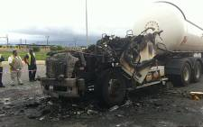 Cape Town fire fighters put out the burning truck at Afrox in Epping on 3 October 2012. Picture: Malungelo Booi/EWN