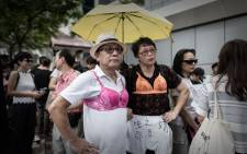 Protesters wear bras during a demonstration outside the police headquarters in Hong Kong on 2 August, 2015. Picture: AFP.