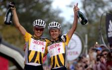 Christoph Sauser and Burry Stander pictured here celebrating the overall win during the final stage of the 2011 Absa Cape Epic Mountain Bike stage race. Picture: Karin Schermbrucker/Cape Epic/SPORTZPICS