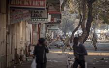 Smoke is seen in the distance during election protests in Zimbabwe. Several people were injured in clashes with security officials on 1 August 2018. Picture:  Thomas Holder/EWN