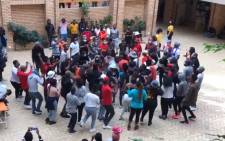 A screengrab of students protesting in the Kramer Building at the University of Cape Town on 12 March 2021.
