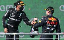 Lewis Hamilton (left) and US Grand Prix winner Max Verstappen celebrate on the podium after the Austin Grand Prix on 24 October 2021. Picture: @F1/Twitter