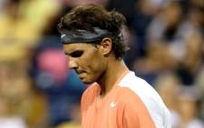 Rafael Nadal was sent packing by Ukraine's Alexandr Dolgopolov who beat him 6-3 3-6 7-6 (7-5). Picture: AFP.