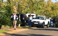 Investigators carry files gathered from Nico Henning's property. Picture: Barry Bateman/EWN