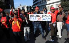 FILE: A group of protesters gather outside Cosatu headquarters in Johannesburg in May 2013 after the march against e-tolls was cancelled. Picture: Sapa.