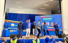 Democratic Alliance leader John Steenhuisen (blue jacket and light pants), Nelson Mandela Bay Mayor Nqaba Bhanga and DA federal chairperson, Helen Zille (right) dance on stage at the launch of the party's election manifesto on 4 October 2021. Picture: @Our_DA/Twitter