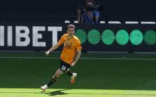 FILE: Wolverhampton Wanderers' Portuguese midfielder Diogo Jota celebrates after scoring their third goal during the English Premier League football match between Wolverhampton Wanderers and Everton at the Molineux stadium in Wolverhampton, central England on 12 July 2020. Picture: AFP.