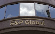 FILE: The S&P Global logo is seen outside a building in Washington, DC, on 25 July 2019. Picture: AFP