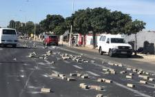 The streets of Gugulethu are full of bricks on Sunday 25 February after a violent protest. Picture:Kevin Brandt/EWN