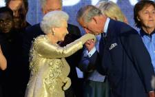 Prince Charles kisses the hand of Britain's Queen Elizabeth II after the Jubilee concert at Buckingham Palace.