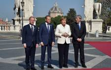 (LtoR) Malta's Prime minister Joseph Muscat, European Council President Donald Tusk, German Chancellor Angela Merkel and Italy's Prime Minister Paolo Gentiloni pose for pictures ahead of a special summit of EU leaders to mark the 60th anniversary of the bloc's founding Treaty of Rome, on 25 March 25 2017 at Rome's Piazza del Campidoglio (Capitoline Hill). Picture: AFP.