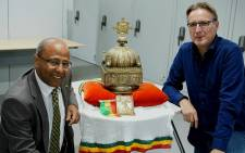 In this file photo taken on 27 August 2019 Dutch-Ethiopian Sirak Asfaw (L) and Dutch art detective Arthur Brand pose with an 18th-century Ethiopian crown at an undisclosed high-security storage facility in the Netherlands. Picture: AFP