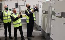 Minister for Health, Stephen Donnelly, Paul Reid, CEO, HSE (Health Service Executive) and Professor Brian MacCraith, chairperson of the High-Level Task Force take delivery of the first doses of the Pfizer BioNTech Covid-19 vaccine at a secure location in Ireland on December 26, 2020. Picture: Marc O'Sullivan / POOL / AFP