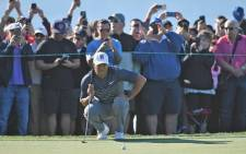 Tiger Woods lines up a putt on the 13th green during the second round of the Farmers Insurance Open golf tournament at Torrey Pines Municipal Golf Course. Picture: @PGATOUR/Twitter.