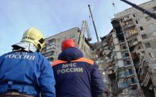 This handout photograph released by The Russian Emergency Situations Ministry on 2 January 2019, shows officers taking part in a rescue operation two days after a gas explosion rocked a residential building in Russia's Urals city of Magnitogorsk. Picture: AFP