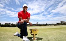 Tiger Woods poses next to the Presidents Cup trophy in Australia where the event will be held. Picture: @TigerWoods/Twitter.