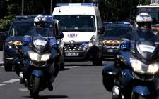 Gendarmes escort a prison van transporting Felicien Kabuga, one of the last key fugitives wanted over the 1994 Rwandan genocide, to the Paris court on 19 May 2020. Picture: AFP