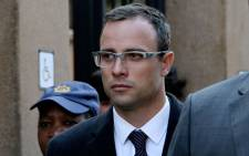Oscar Pistorius arrives at the High Court IN Pretoria ahead of his trial on 8 April 2014. Picture: Sebabatso Mosamo/EWN.