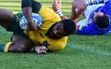 Australia's wing Marika Koroibete scores a try during the international rugby union test match Italy vs Australia on 17 November 2018 at the Euganeo stadium in Padua. Picture: AFP.