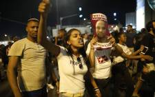 Members of the Israeli Ethiopian community gesture as demonstrators block the main entrance to Jerusalem on 3 July 2019, to protest the killing of Solomon Tekah, a young man of Ethiopian origin who was killed by an off-duty police officer. Picture: AFP