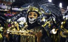 FILE: Members of the Mangueira samba school perform during the first night of Rio's carnival parade at the Sambadrome in Rio de Janeiro, Brazil on 23 February 2020. Picture: AFP