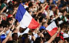 France soccer fans waving their country's flag in support of the team during a World Cup match. Picture: @FrenchTeam/Twitter.