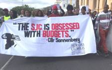 SJC activists march to the Cape Town Civic Centre to hand over a memorandum on the city's budget. Picture: Xolani Koyana/EWN.