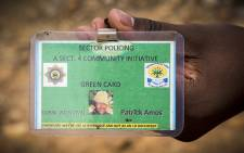 Patrick Amos's green card which he says he is being made to carry like the 'dompas' system. Picture: Thomas Holder/EWN.