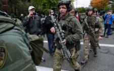 Rapid reaction SWAT members leave the scene of a mass shooting at the Tree of Life Synagogue in the Squirrel Hill neighbourhood on 27 October 2018 in Pittsburgh, Pennsylvania. Picture: AFP.