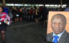 Posters of Collins Chabane have been set up throughout the memorial service venue on 19 March 2015. Picture: Govan Whittles/EWN