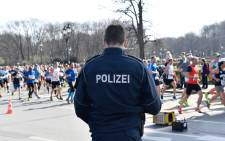Police patrol during the half-marathon in Berlin on 8 April 2018. Picture: AFP