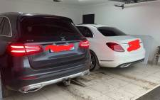 The intelligence-driven operation on Thursday, 14 January 2021 led the team to a house in Sharpeville where police found the sought Mercedes Benz GLC SUV plus a Mercedes Benz sedan that has since been confirmed as sought by police in a case reported at Dawn Park SAPS in December 2020. Picture: SAPoliceService/Facebook