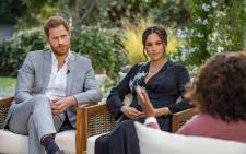 This undated image released 7 March 2021 courtesy of Harpo Productions shows Britain's Prince Harry and his wife Meghan, Duchess of Sussex, in a conversation with US television host Oprah Winfrey. Picture: Joe Pugliese/Harpo Productions/AFP.