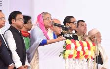 Bangladesh Prime Minister Sheikh Hasina (C) speaks during an election campaign rally in Dhaka on 24 December 2018. Prime Minister Sheikh Hasina heads to the polls in Bangladesh this week on course for a historic victory, while her ailing opponent faces an uncertain future in a colonial-era Dhaka jail. Picture: AFP