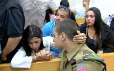 FILE: This screengrab shows Sergeant Elor Azaria being comforted by a relative in court ahead of trial. Picture: YouTube.com